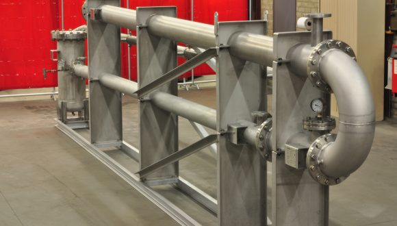 Biogas cooling and reheating system
