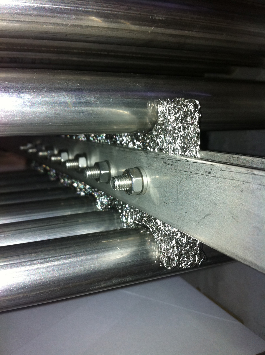 cleaning of tubes using fooling scraper in heat exchanger
